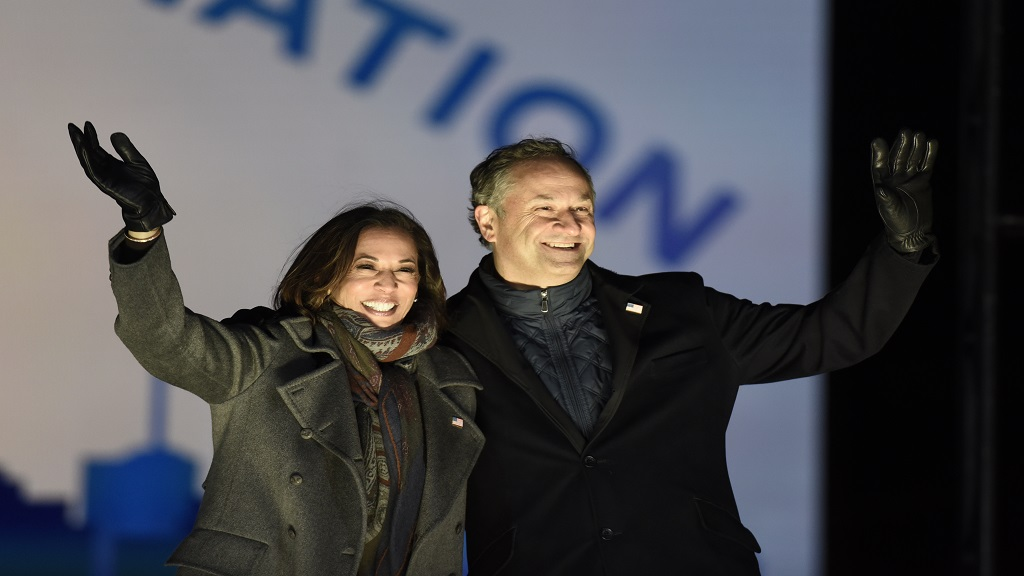 Democratic vice presidential candidate Senator Kamala Harris, D-California, and her husband Doug Emhoff take the stage during a drive-in get out the vote rally, Monday, November 2, 2020, in Philadelphia. (AP Photo/Michael Perez)