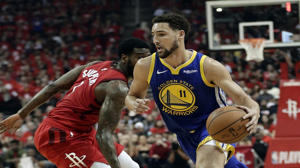 In this May 10, 2019, file photo, Golden State Warriors' Klay Thompson (11) drives past Houston Rockets' Iman Shumpert during the first half of Game 6 of a second-round NBA basketball playoff series in Houston.  (AP Photo/Eric Gay, File).
