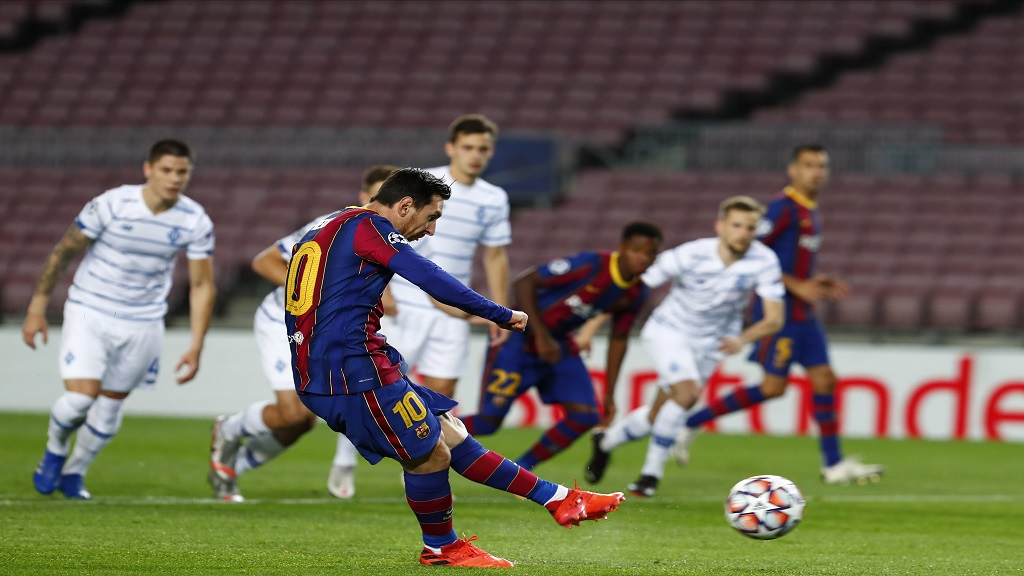 Barcelona's Lionel Messi scores a penalty kick during the Champions League group G football match against Dynamo Kyiv at the Camp Nou stadium in Barcelona, Spain, Wednesday, Nov. 4, 2020. (AP Photo/Joan Monfort).