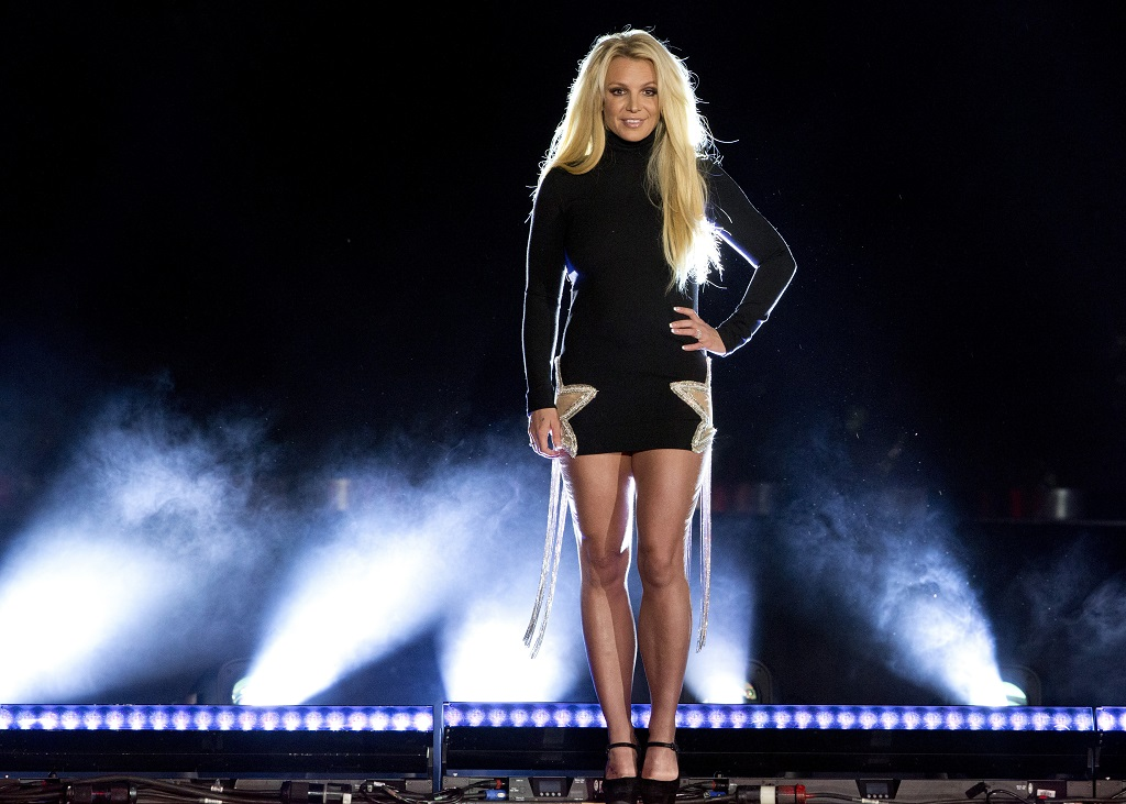 FILE - In this Thursday, October 18, 2018, file photo, singer Britney Spears makes an appearance in front of the Park MGM hotel-casino in Las Vegas. Spears wants to be freed from her father. In a recent series of court manoeuvres, Spears has sought greater say over her life and affairs, which for years have been under the control of a court conservatorship run mostly by her father, James Spears. (Steve Marcus/Las Vegas Sun via AP, File)