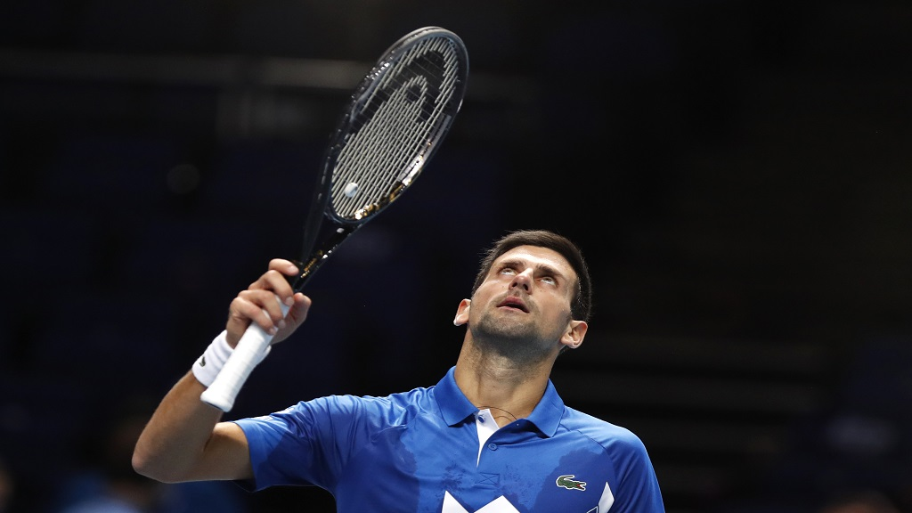 Novak Djokovic of Serbia celebrates winning match point against Alexander Zverev of Germany during their singles tennis match at the ATP World Finals tennis tournament at the O2 arena in London, Friday, Nov. 20, 2020. (AP Photo/Frank Augstein).