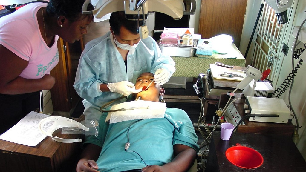 A patient receiving treatment at the Portmore Dental Clinic.