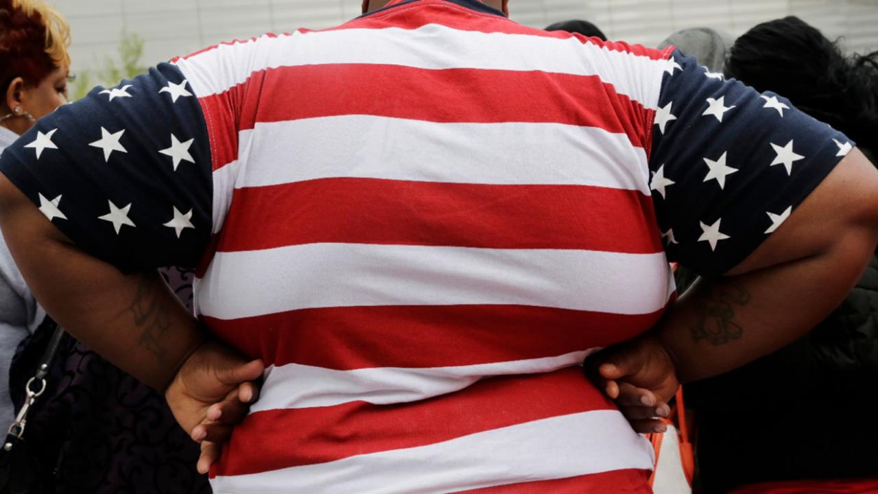 In this May 8, 2014, file photo, an overweight person is seen in New York. As obesity rates climb in the US, more Americans say they're following special diets compared to a decade ago. (AP Photo/Mark Lennihan, File)