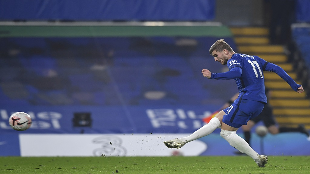 Chelsea's Timo Werner scores his side's fourth goal during the English Premier League football match against Sheffield United at Stamford Bridge Stadium in London, Saturday, Nov. 7, 2020. (Ben Stansall/Pool via AP).
