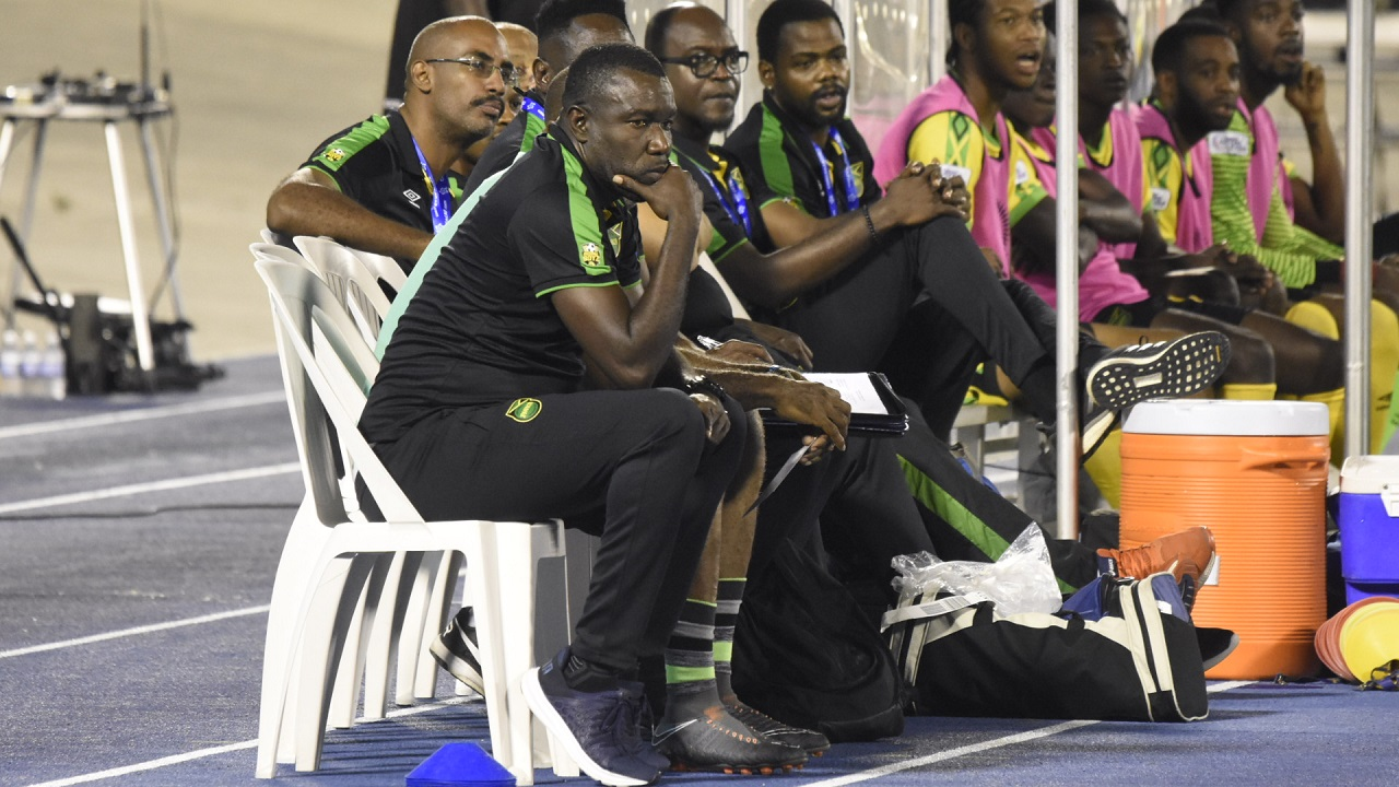File photo of the technical team of the Reggae Boyz on the sidelines at a football match.