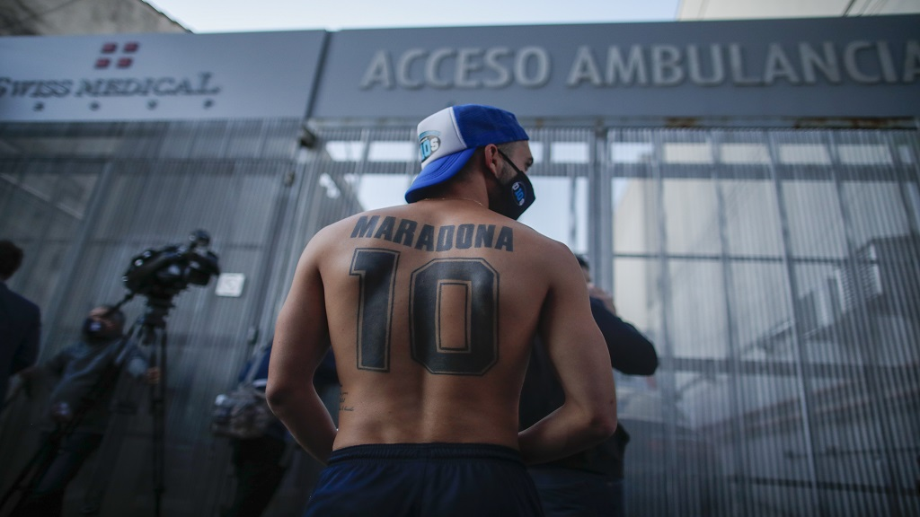Football fans gathered outside Clinica Olivos just before former football star Diego Maradona's surgery in Buenos Aires, Argentina, Tuesday, Nov. 3, 2020. (AP Photo/Natacha Pisarenko).