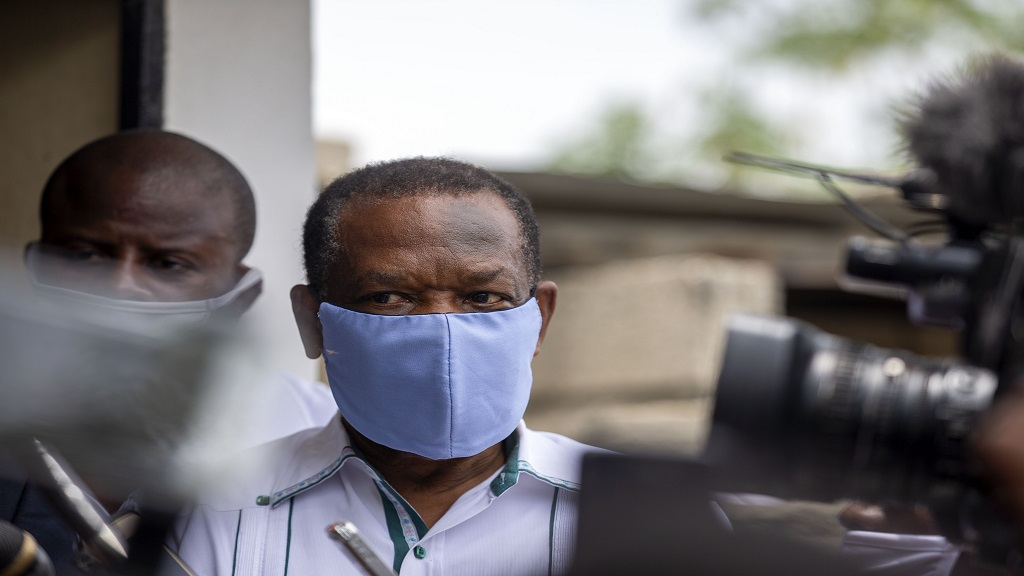 In this file photo dated Thursday, May 21, 2020, Yves Jean-Bart, president of the Haitian Football Federation, wearing a protective face mask, arrives for a court hearing regarding allegations that he abused female athletes at the country's national training centre, in Croix-des-Bouquets, Haiti.  (AP Photo/Dieu Nalio Chery, FILE).