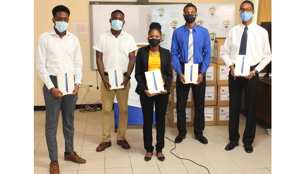 The University of Technology's participants in Huawei' Seeds of the Future programme; (from left) Dylan Lewis, Alex Downer, Alecia Bailey, Chadan Huggup and Casandru Bartley holding their new Huawei Tablet on October 28 at the Handover donation event at UTech.