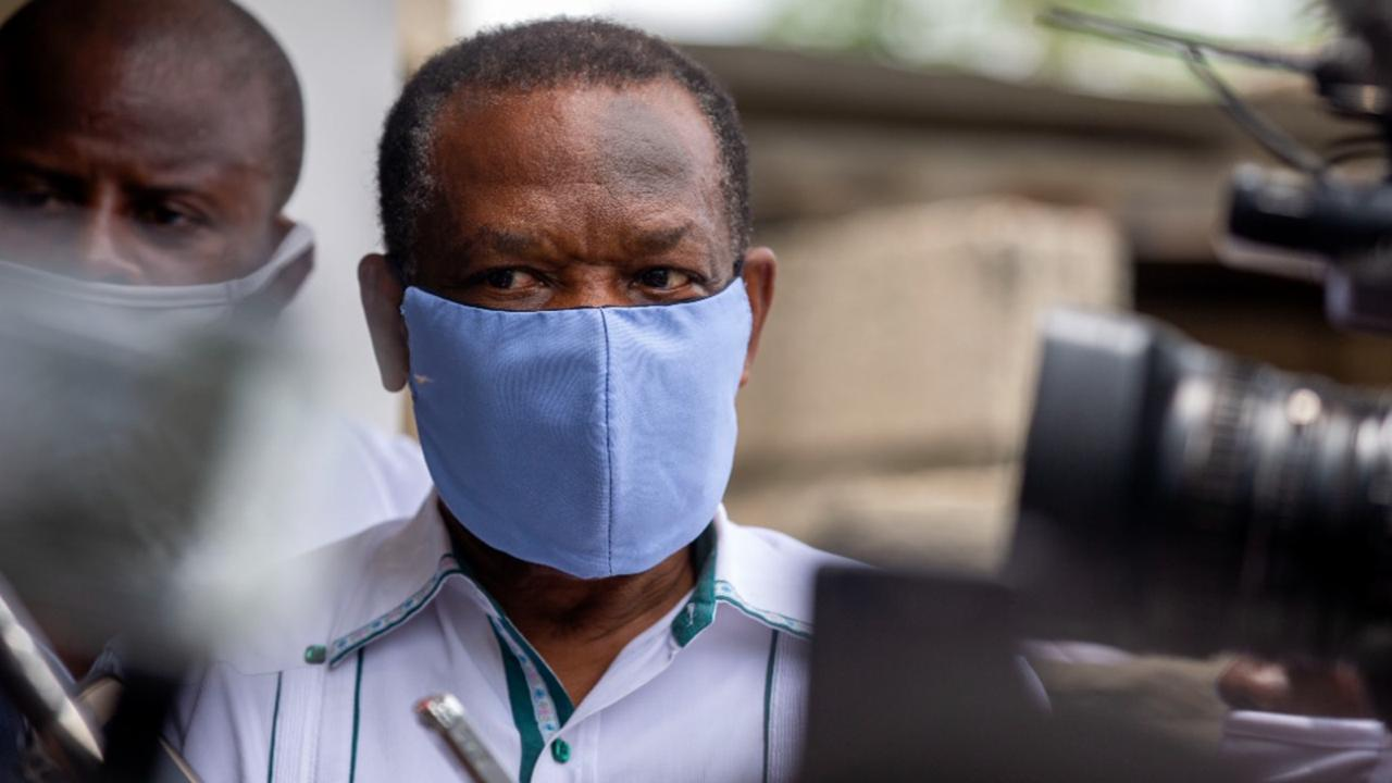 In this file photo dated Thursday, May 21, 2020, Yves Jean-Bart, president of the Haitian Football Federation, wearing a protective face mask, arrives for a court hearing regarding allegations that he abused female athletes at the country's national training centre, in Croix-des-Bouquets, Haiti. (AP Photo/Dieu Nalio Chery, FILE)