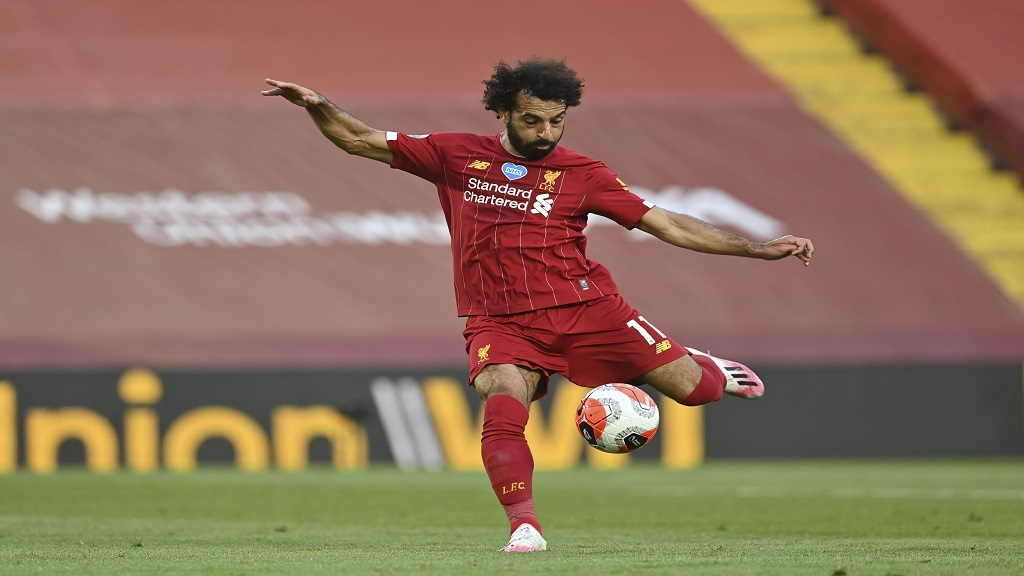 Liverpool's Mohamed Salah scores the second goal during the English Premier League football match against Crystal Palace at Anfield Stadium in Liverpool, England, Wednesday, June 24, 2020. (Paul Ellis/Pool via AP).