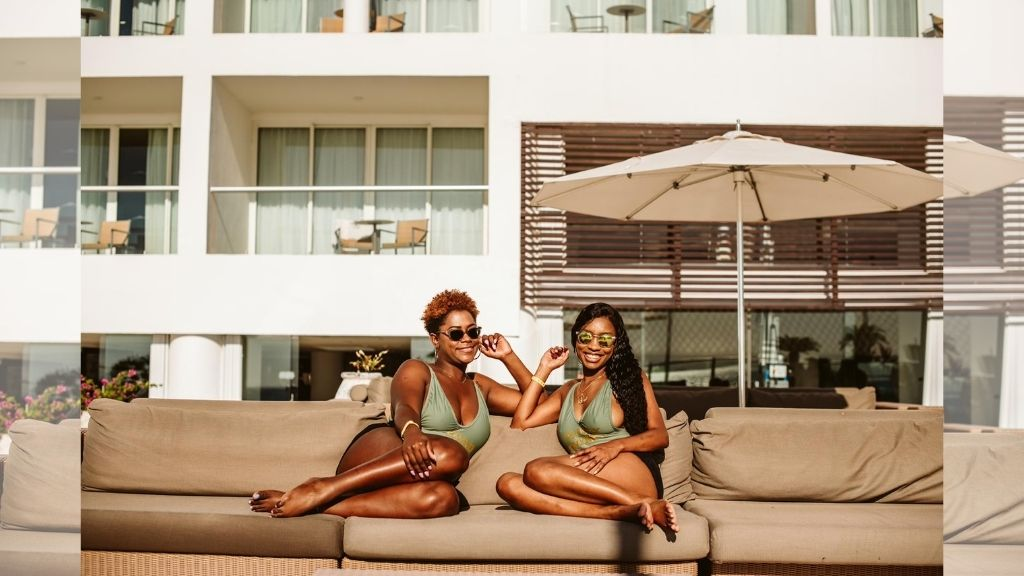 Kristene Douglas (left) and her best friend Rochelle Buddan lounge by the pool at the Playacar Palace resort in Mexico. (Photos: Contributed)