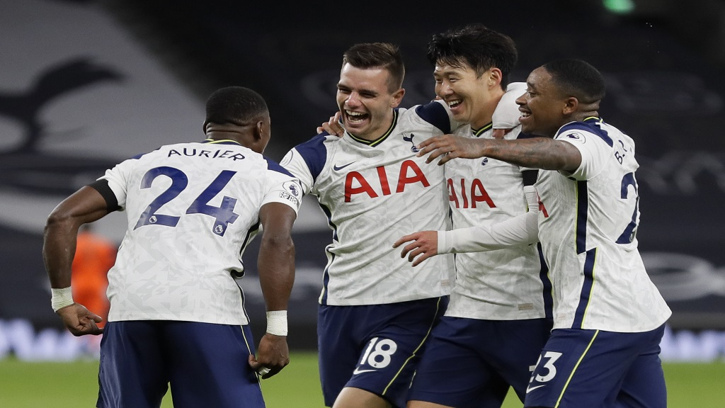 Tottenham's Giovani Lo Celso, second left, celebrates after scoring his side's second goal during an English Premier League football match against Manchester City at Tottenham Hotspur Stadium in London, England, Saturday, Nov. 21, 2020. (AP Photo/Kirsty Wigglesworth, Pool).