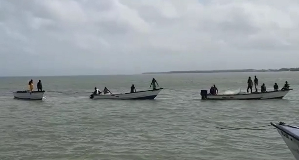 File footage of local fishermen at sea.