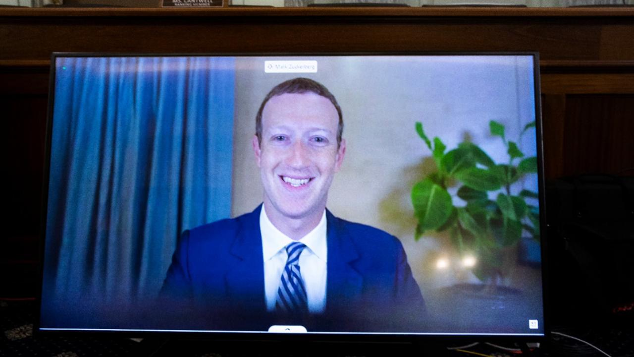 In this October 28, 2020 file photo, Facebook CEO of Mark Zuckerberg appears on a screen as he speaks remotely during a hearing before the Senate Commerce Committee on Capitol Hill in Washington. (Michael Reynolds/Pool via AP)