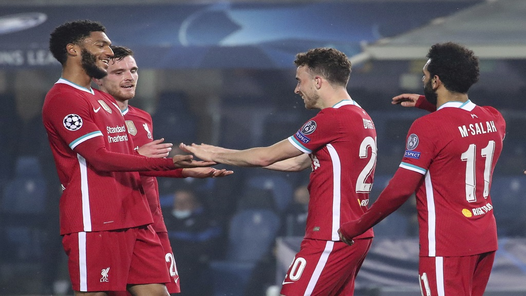 Liverpool's Diogo Jota, centre, celebrates after scoring his second goal against Atalanta during the Champions League, group D football match at the Gewiss Stadium in Bergamo, Italy, Tuesday, Nov. 3, 2020. (Stefano Nicoli/LaPresse via AP).