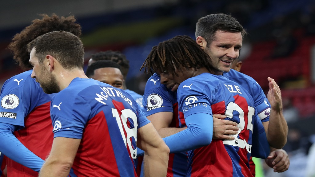 Crystal Palace's Eberechi Eze celebrates with Scott Dann, right, after scoring his side's second goal during the English Premier League football match against Leeds United at the Selhurst Park stadium in London, England, Saturday, Nov. 7, 2020. (Naomi Baker/Pool via AP).