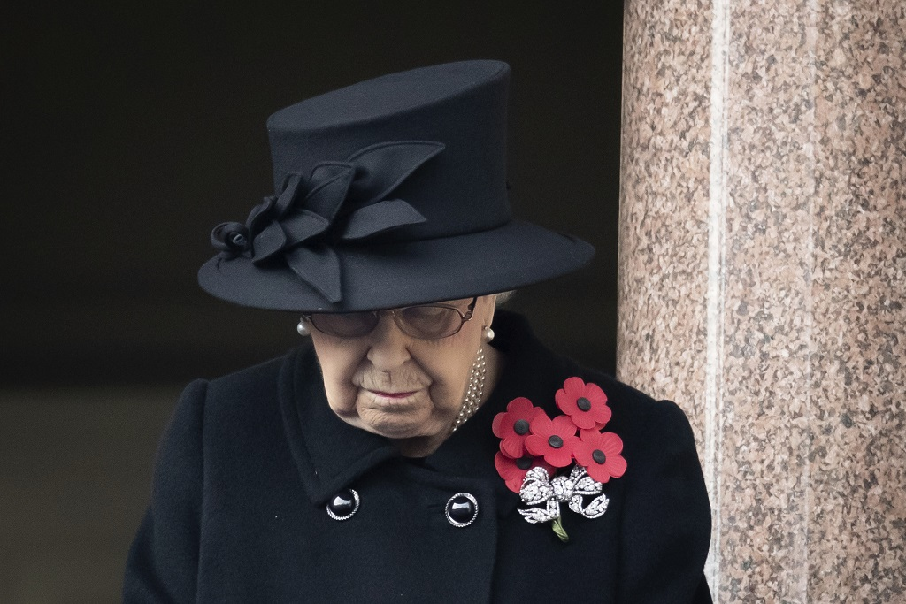 Britain's Queen Elizabeth II stands on the balcolny of the Foreign Office, during the Remembrance Sunday service at the Cenotaph, in Whitehall, London, Sunday November 8, 2020. (Aaron Chown/Pool Photo via AP)