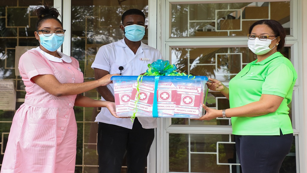 Executive members of the University of the West Indies' Nursing Students' Association, (from left) Vice President, Shannon Pike and President Aaron Lawrence, accept a container of medical personal protective equipment from Shelley Ebanks-McGregor, Project Manager at Sagicor Bank Jamaica and Sagicor Foundation Volunteer, at the UWI School of Nursing last week.