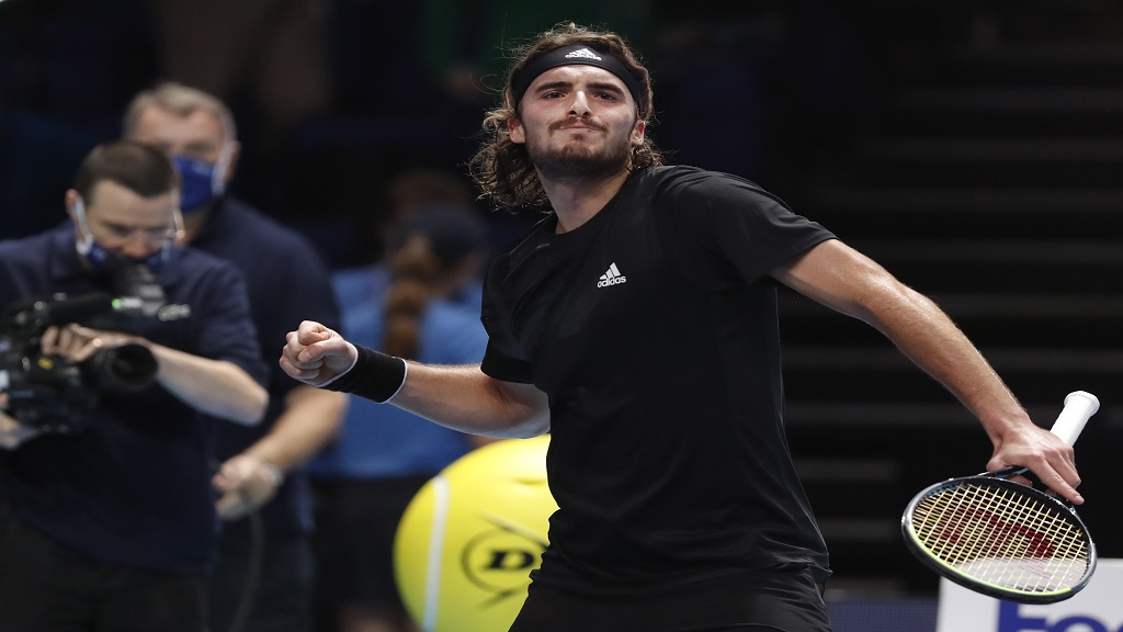 Stefanos Tsitsipas of Greece celebrates winning match point against Andrey Rublev of Russia during their singles tennis match at the ATP World Finals tennis tournament at the O2 arena in London, Tuesday, Nov. 17, 2020. (AP Photo/Frank Augstein).