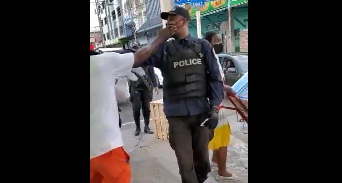 A screenshot of a video in which a police officer and vendor square off.