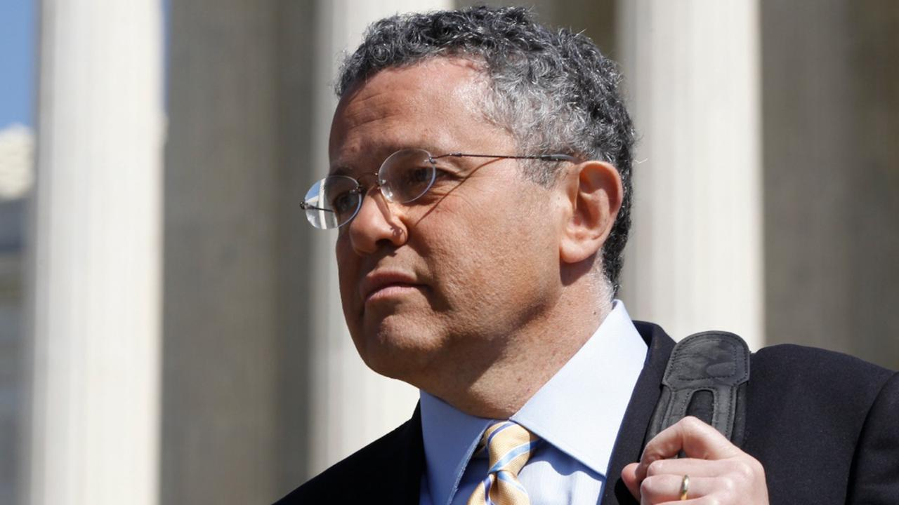 CNN legal analyst Jeffrey Toobin leaves the Supreme Court after it finished the day's arguments on the health care law signed by President Barack Obama in Washington on March 27, 2012. (AP Photo/Charles Dharapak, File)