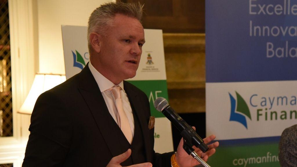 Adrian Lynch speaking on Cayman's reinsurance market in New York