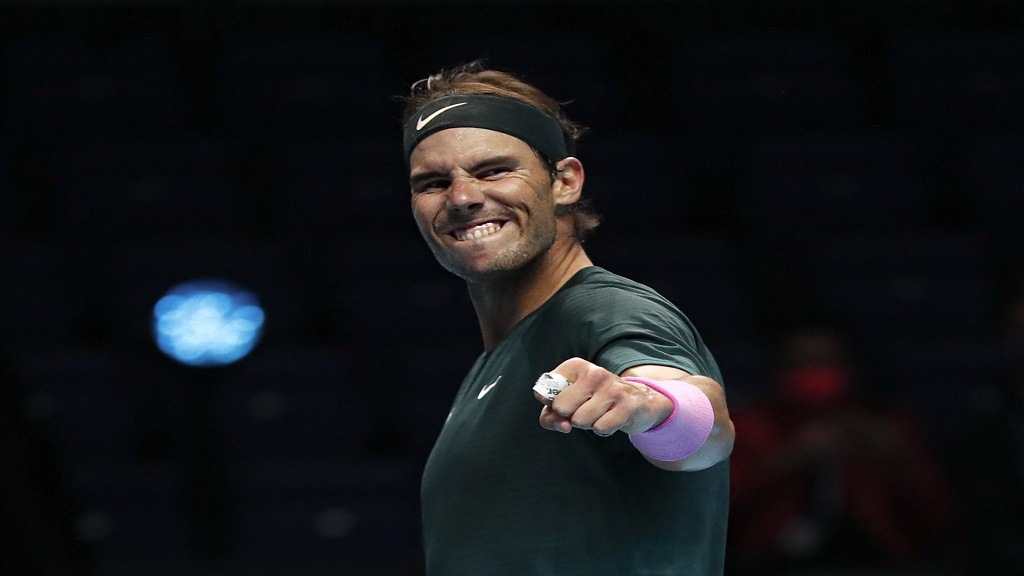Rafael Nadal of Spain celebrates defeating Stefanos Tsitsipas of Greece during their tennis match at the ATP World Finals tennis tournament at the O2 arena in London, Thursday, Nov. 19, 2020. (AP Photo/Frank Augstein).