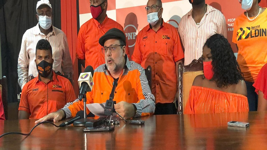 Newly elected People's National Party (PNP) President, Mark Golding (at microphone) addressing the media at the party's headquarters in St Andrew after his victory on Saturday afternoon.