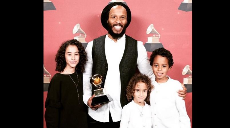 "Ziggy Marley with his children. His new album ""More Family Time"" is out now."