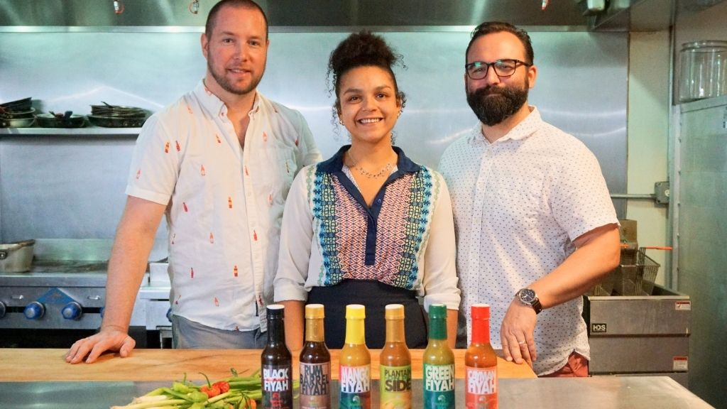 (L-R) Chef Thomas Tennant of Tomfoodery Kitchen, Paige Walton of Tortuga Rum Company and Jonathan Nunez of Tomfoodery Kitchen celebrate their new partnership at the future Tomfoodery Kitchen & Bar.