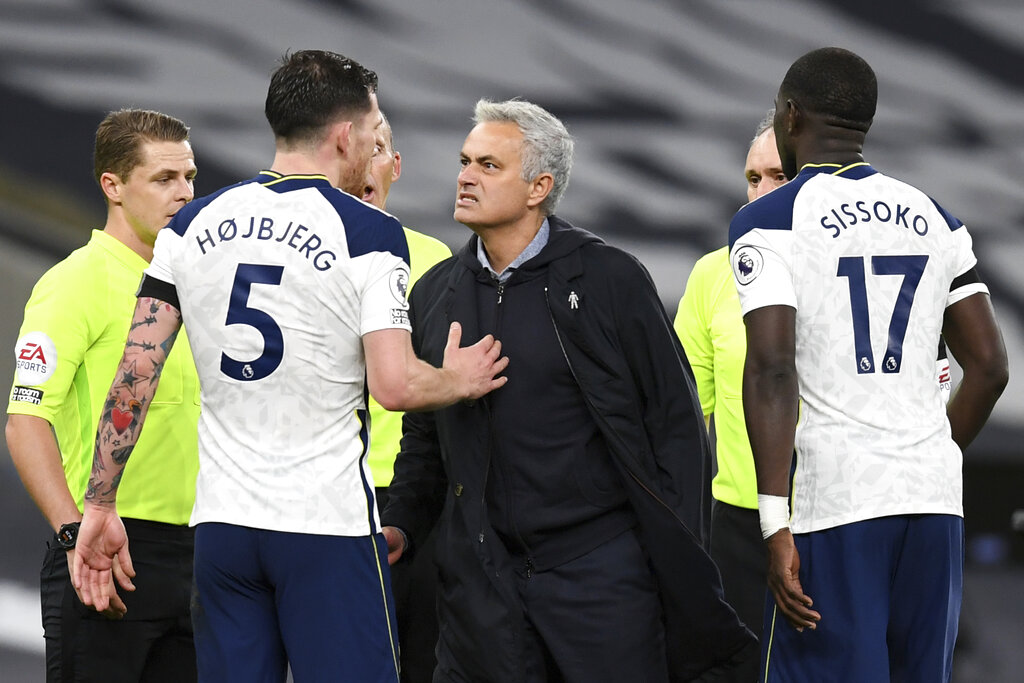 Tottenham's manager Jose Mourinho, centre, reacts as speaks with Tottenham's Pierre-Emile Hojbjerg end of the English Premier League soccer match between Tottenham Hotspur and Manchester City at Tottenham Hotspur Stadium in London, England, Saturday, Nov. 21, 2020. (Neil Hall/Pool via AP)