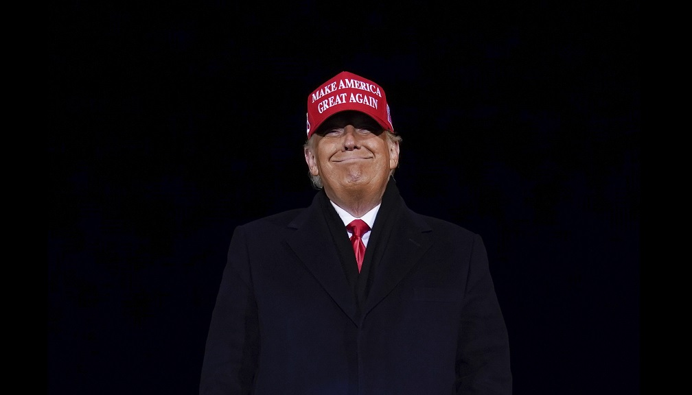President Donald Trump smiles at supporters after a campaign rally at Gerald R Ford International Airport, early Tuesday, November 3, 2020, in Grand Rapids, Mich. (AP Photo/Evan Vucci)