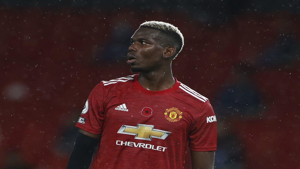 Manchester United's Paul Pogba gestures during the English Premier League football match against Arsenal at the Old Trafford stadium in Manchester, England, Sunday, Nov. 1, 2020. (Phil Noble/Pool via AP).