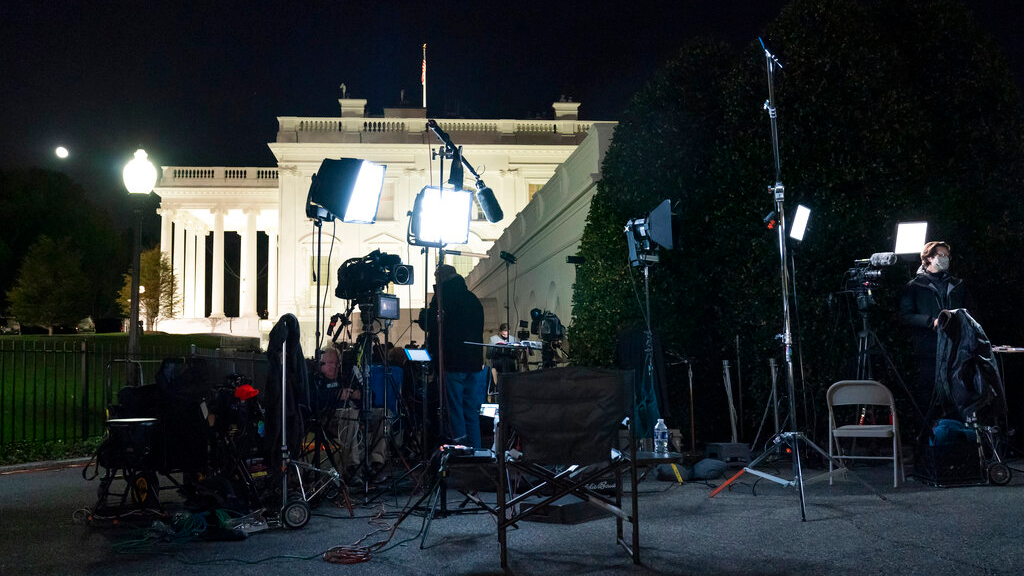 Members of the news media work outside the West Wing of the White House, election night, Tuesday, Nov. 3, 2020, in Washington. (AP Photo/Alex Brandon)