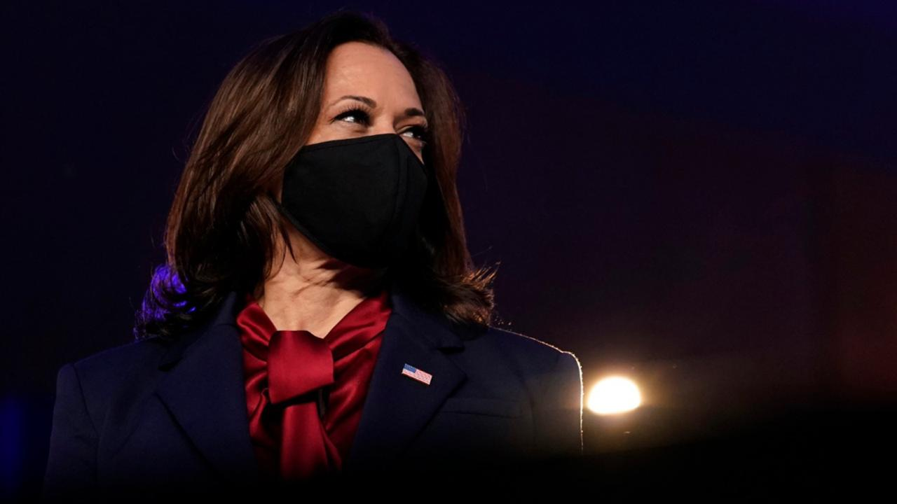 Democratic vice-presidential candidate Sen. Kamala Harris, D-Calif., listens as Democratic presidential candidate former Vice President Joe Biden speaks Friday, November 6, 2020, in Wilmington, Del. (AP Photo/Carolyn Kaster)