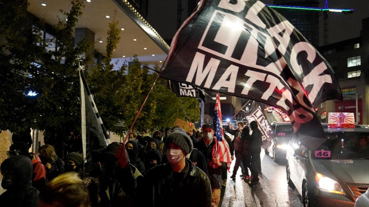 People march on the night of the election in Seattle, Tuesday, November 3, 2020. (AP Photo/Ted S. Warren)