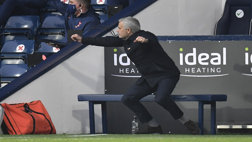 Tottenham's manager Jose Mourinho celebrates after Harry Kane scores his side's opening goal during an English Premier League match against West Bromwich Albion at the Hawthorns in West Bromwich, England, Sunday, Nov. 8, 2020. (Peter Powell/Pool via AP).