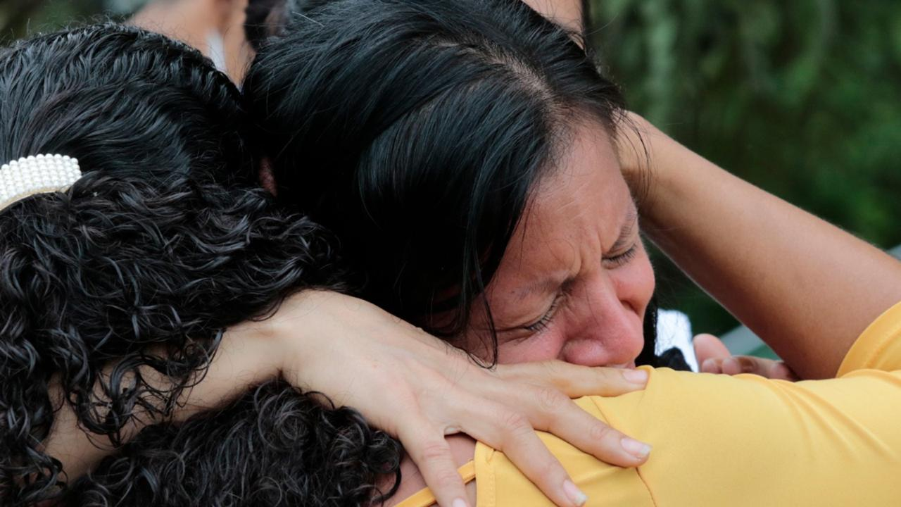 Mirian Najera is comforted upon learning about the death of her mother Maria Mejia, in Planeta, Honduras, Friday, November 6, 2020. (AP Photo/Delmer Martinez)