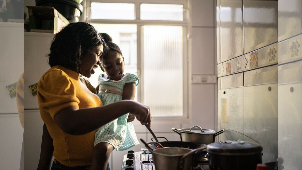 Erika Navarrete Nagle, a television producer in Denver, Colorado, preparing a meal for her family in Denver. Before she began quarantining in late March, the 33-year-old had never cooked chicken. (William Nagle via AP)