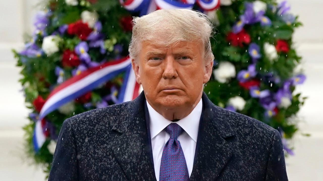 President Donald Trump participates in a Veterans Day wreath-laying ceremony at the Tomb of the Unknown Soldier at Arlington National Cemetery in Arlington, Va., Wednesday, November 11, 2020. (AP Photo/Patrick Semansky)