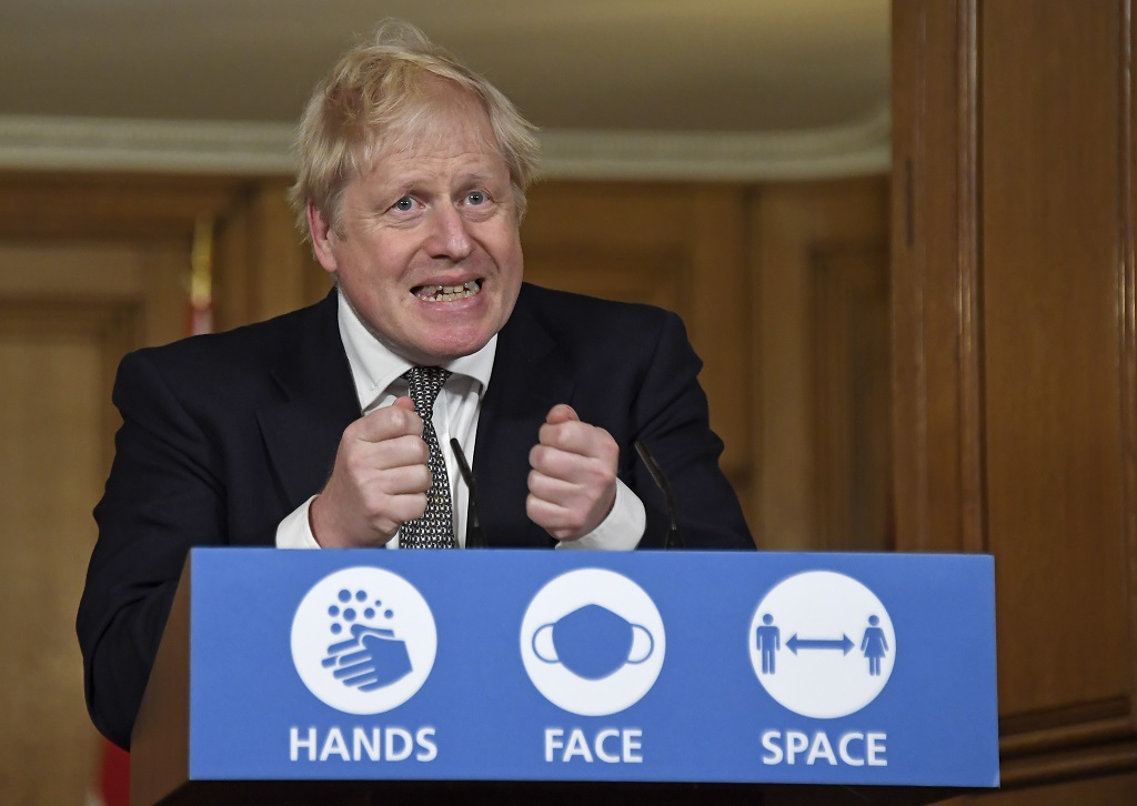 Britain's Prime Minister Boris Johnson gestures as he speaks during a press conference in 10 Downing Street, London, Saturday, October 31, 2020 where he is expected to announce new restrictions to help combat a coronavirus surge. (AP Photo/Alberto Pezzali, Pool)