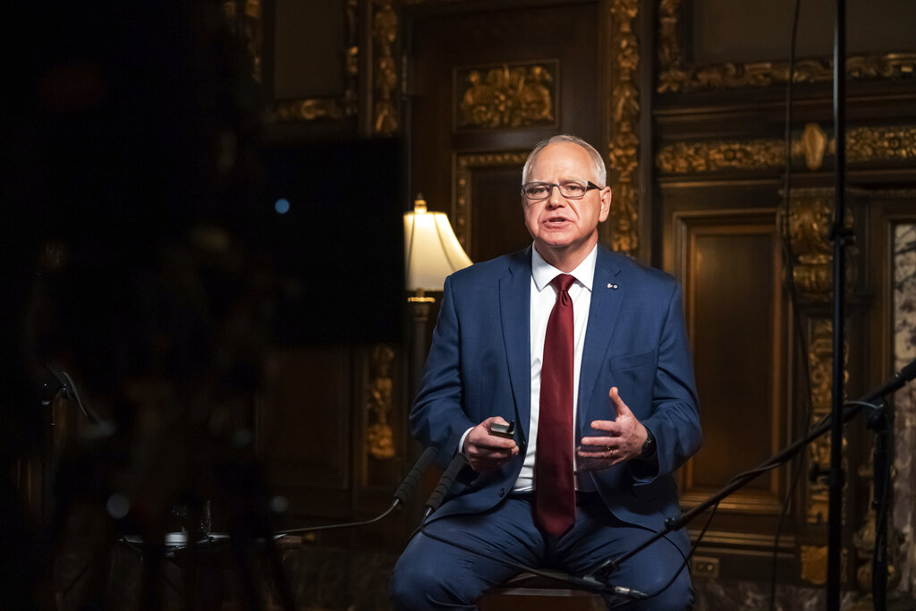 Minnesota Gov Tim Walz speaks from the Governor's Reception room at the State Capitol, to discuss the latest steps in his response to COVID-19, Wednesday, Nov 18, 2020, in St Paul, Minn (Glen Stubbe/Star Tribune via AP, Pool)