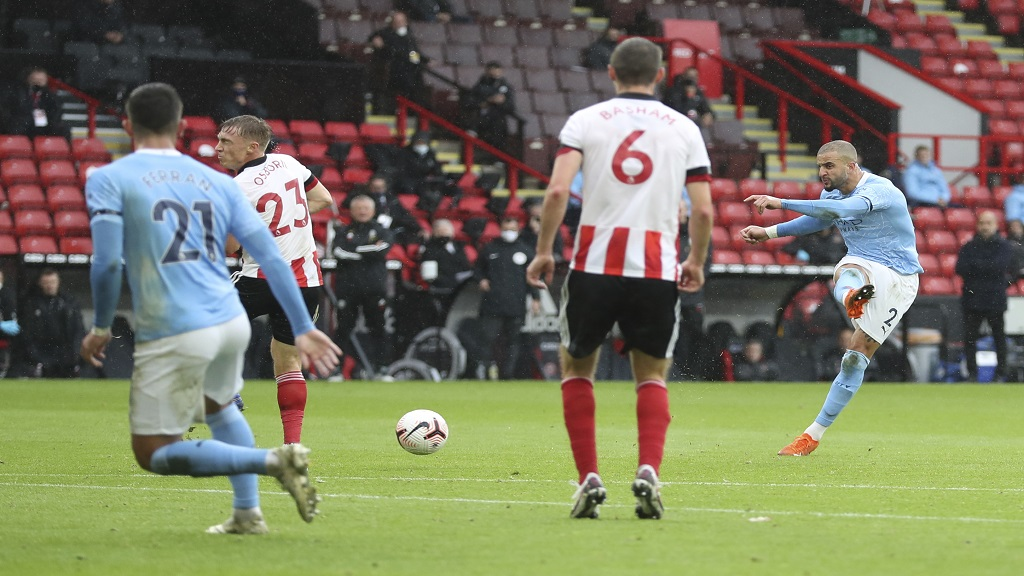 Manchester City's Kyle Walker, right, scores during the English Premier League football match against Sheffield United at Bramall Lane stadium in Sheffield, England, Saturday, Oct. 31, 2020. (Cath Ivill/Pool via AP).