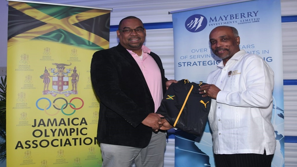 Jamaica Olympic Association (JOA) president, Christopher Samuda (right), presenting a Jamaica shirt to Mayberry CEO Gary Peart.