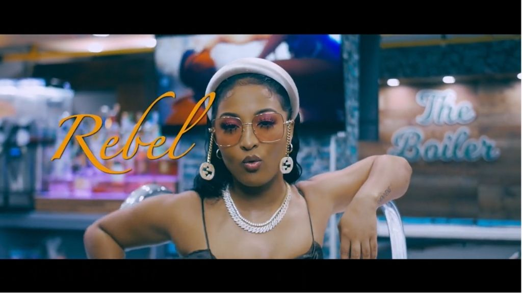 A screengrab of dancehall recording artist Shenseea in a scene from Rebel. (Photos: via YouTube)