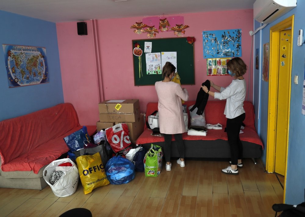 Social workers sort goods donated, in Svratiste, or Roadhouse, Belgrade's first daily drop-in center for street children, in Serbia. (AP Photo/Darko Vojinovic)