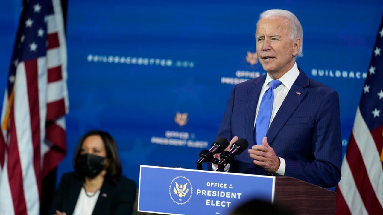 President-elect Joe Biden speaks as Vice President-elect Kamala Harris listens at left, during an event to introduce their nominees and appointees to economic policy posts at The Queen theater, Tuesday, December 1, 2020, in Wilmington, Del. (AP Photo/Andrew Harnik)