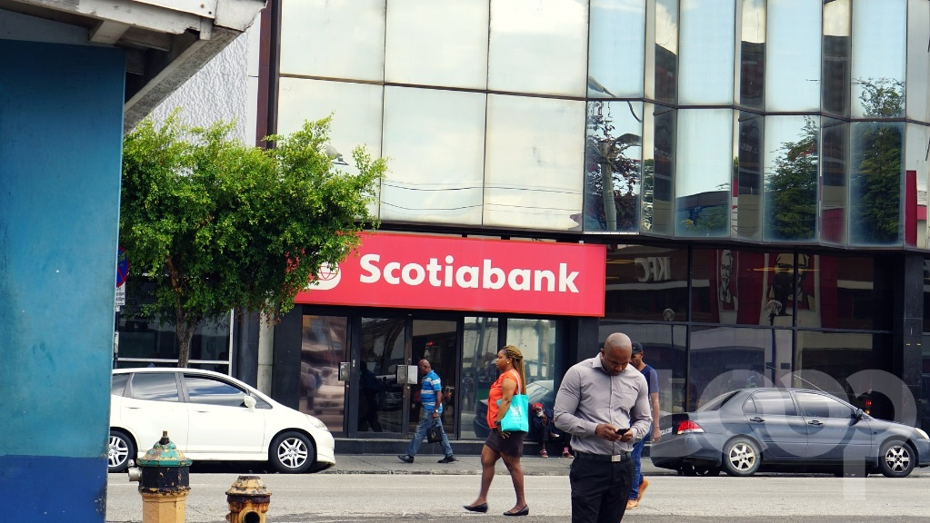 File: People walk past Scotiabank, Independence Square, Port-of-Spain.