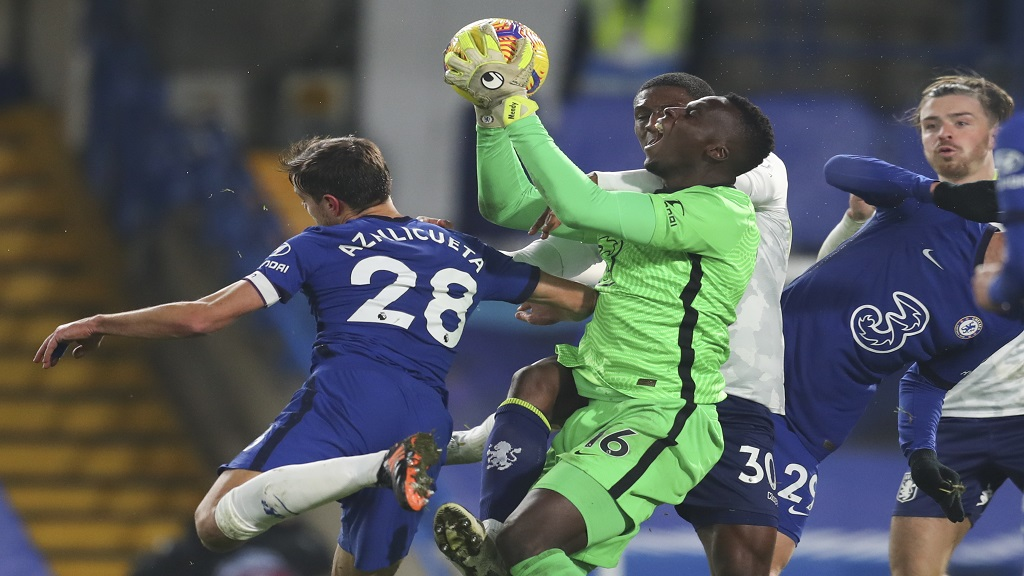 Chelsea's goalkeeper Edouard Mendy screams as he saves during the English Premier League football match against Aston Villa in London England Monday Dec. 28 2020. The game ended 1-1