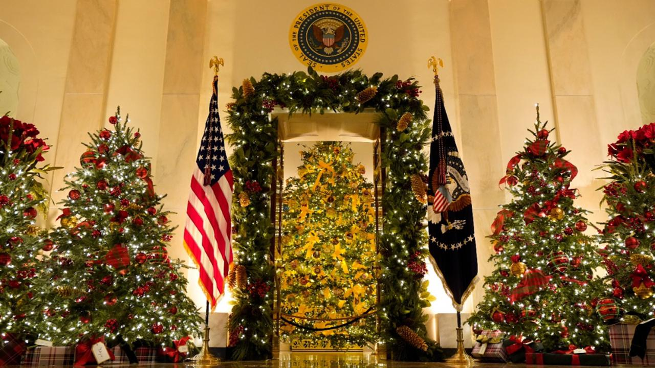 Cross Hall and the Blue Room are decorated during the 2020 Christmas preview at the White House, Monday, November 30, 2020, in Washington. (AP Photo/Patrick Semansky)
